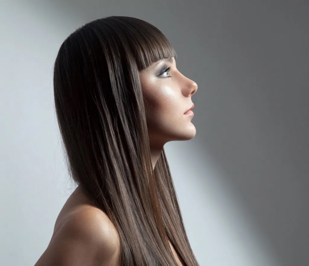 Straightening hair with relaxing treatments.